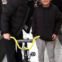 Paul Powell and kid with bike Day of Kings