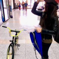 Girl with bike and helmet 2019 day of kings