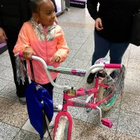 young girl and bike 2019 Day of Kings