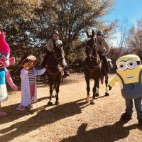 Costumes and horses community picnic
