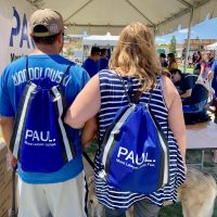Couple with Paul Powell merchandise
